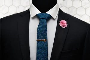 The Dear Martian, Brooklyn Ditsy floral neck tie is paired up and displayed on a mannequin with our Connors gold fleur de list tie clip and pink gingham flower lapel pin.