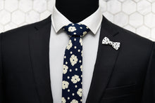 The Poplar indigo navy floral tie by Dear Martian, is paired with a matching polka dot bow shaped lapel pin.