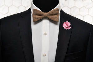 An image of a mannequin sporting our Dear Martian slub linen bow tie with a gingham pink patterned lapel pin.