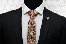 Our Dear Martian red cotton paisley tie is displayed on a mannequin with the Connors gold fleur de lis lapel pin.