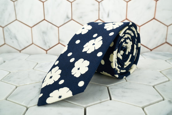 An image of the navy floral, polka-dotted necktie by Dear Martian, Brooklyn.