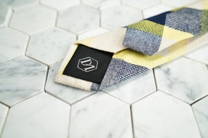 An image of the back of the Flatbush skinny linen blended tie, which features Dear Martian's hex logo.