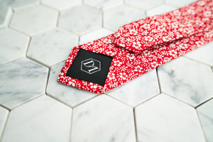 The back of our Dear Martian, Brooklyn Shakespeare Scarlet Red slim necktie shows more detailed shot of the DM hexagonal logo stitched on the tipping.