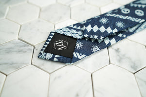 The back of the celtic and skull patterned skinny tie displays the exclusive DM stitched hexagonal logo.