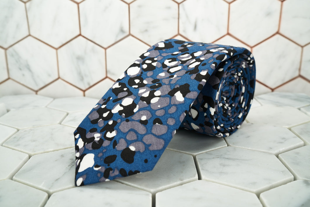 An image of the exclusive Crooke jaguar spotted necktie made by Dear Martian, Brooklyn.