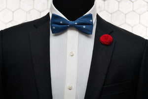 An image of a patriotic mannequin dressed in red, white and blue by accessorizing with Dear Martian products, which include a denim patterned bow tie and red floral lapel pin.
