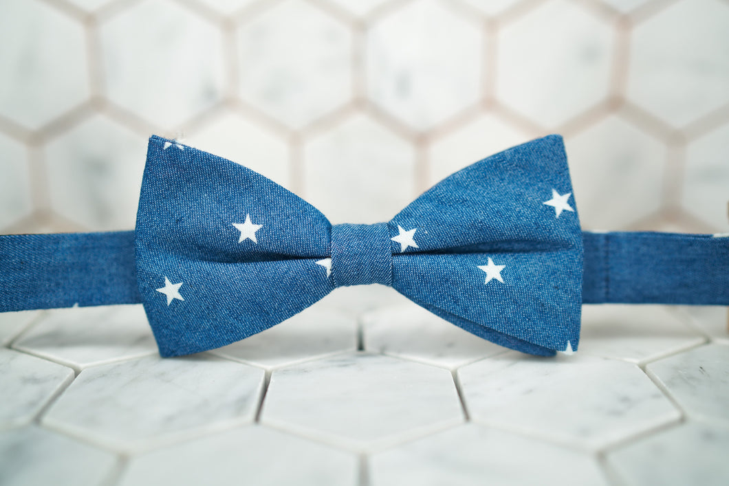 The front image of a denim star patterned bow tie by Dear Martian, Brooklyn.