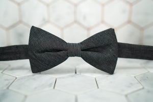 A front view image of the DM raw denim black bow tie.