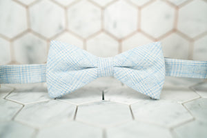 The front image of the Dear Martian Tiffany glen plaid blue bow tie.