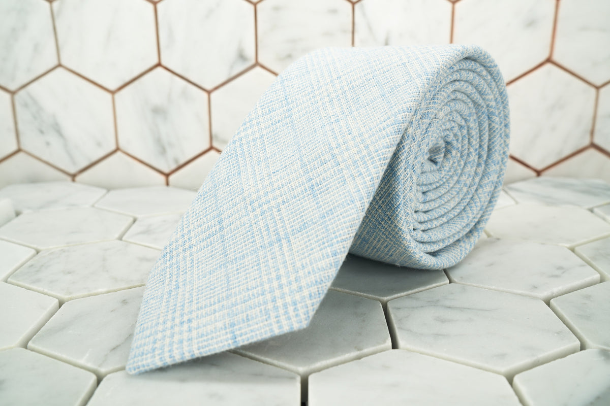 0ae89e148057 A product image of the Tiffany blue glen-plaid linen necktie rolled up; the  ...