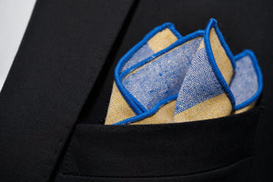 A close up image of the Collegiate, a yellow and blue striped pocket square handmade by Dear Martian.