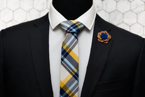 A Dear Martian mannequin is dressed up in a madras skinny necktie and is paired with a wooden flower lapel pin.