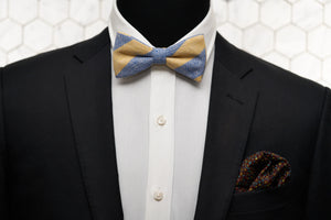 A mannequin is modelling Dear Martian's bow tie with yellow and blue stripes; and a matching floral pocket square.