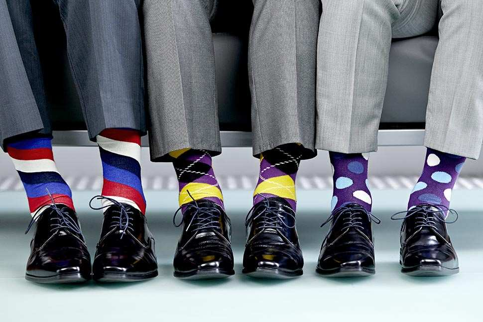 Crazy socks. By know you must have seen them in the office, at some after work bar or at the park. So update your business game with a pair of colorful socks.