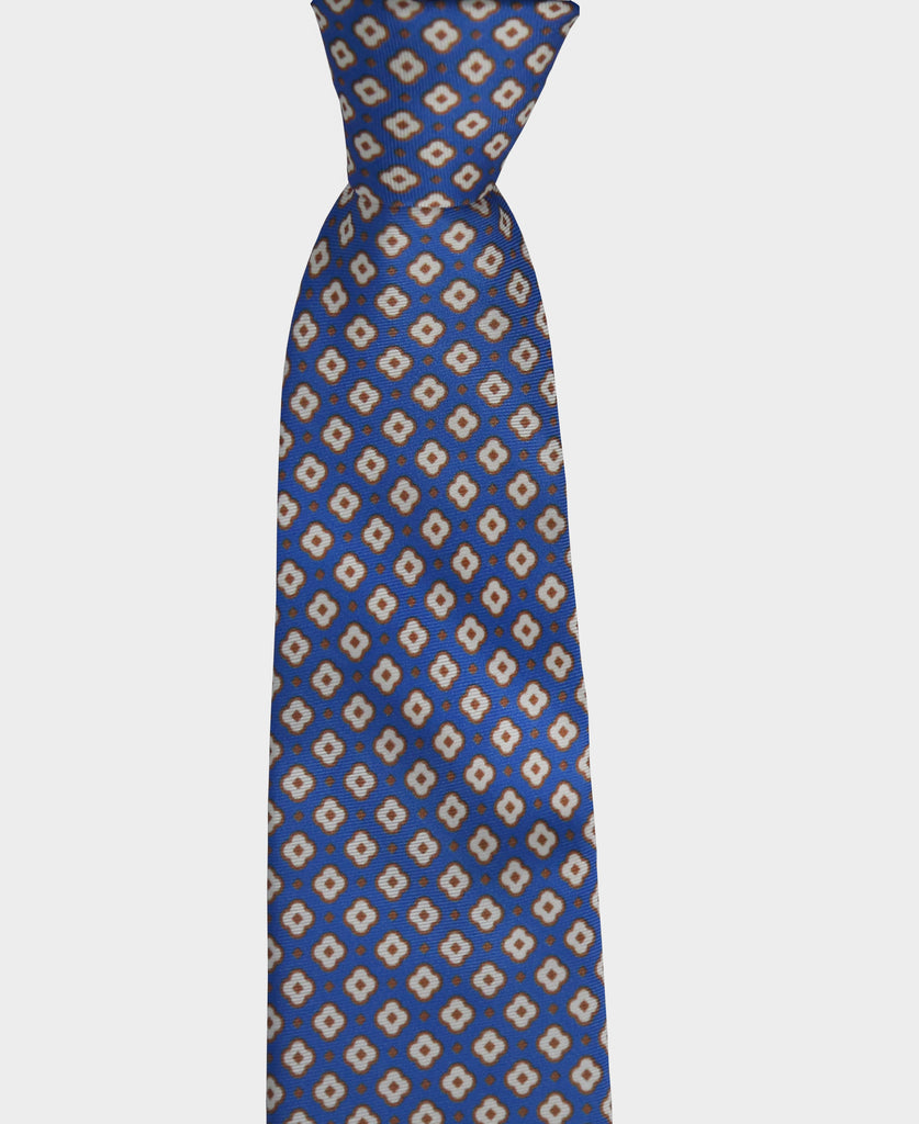 Our blue geometric pattern tie with touches in sand and white, is perfect for a classic and modern look. Its versatile enough to be worn in a formal or a casual environment.