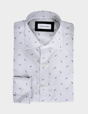 Our version of the polka dots trend. White shirt with navy blue polka dots and L shaped lines.