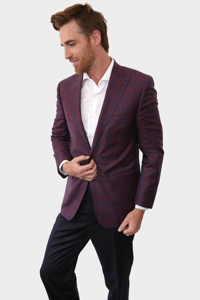 Our Magenta blazer is the definition of versatile, perfect for a meeting with clients or a social event. The blue windowpane pattern makes for a great accent, making it a subtle element of style.