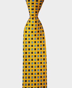 Our colorful yellow tie with blue flowers works great with a white shirt.