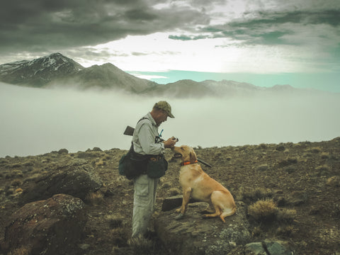 upland hunter in mountains