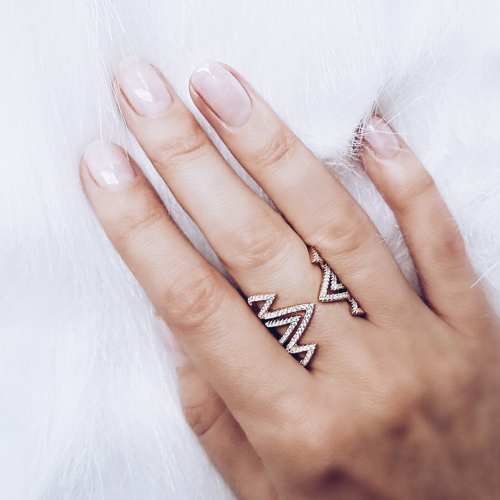 woman wearing Aurum Mod rose gold-plated geometric studded ring