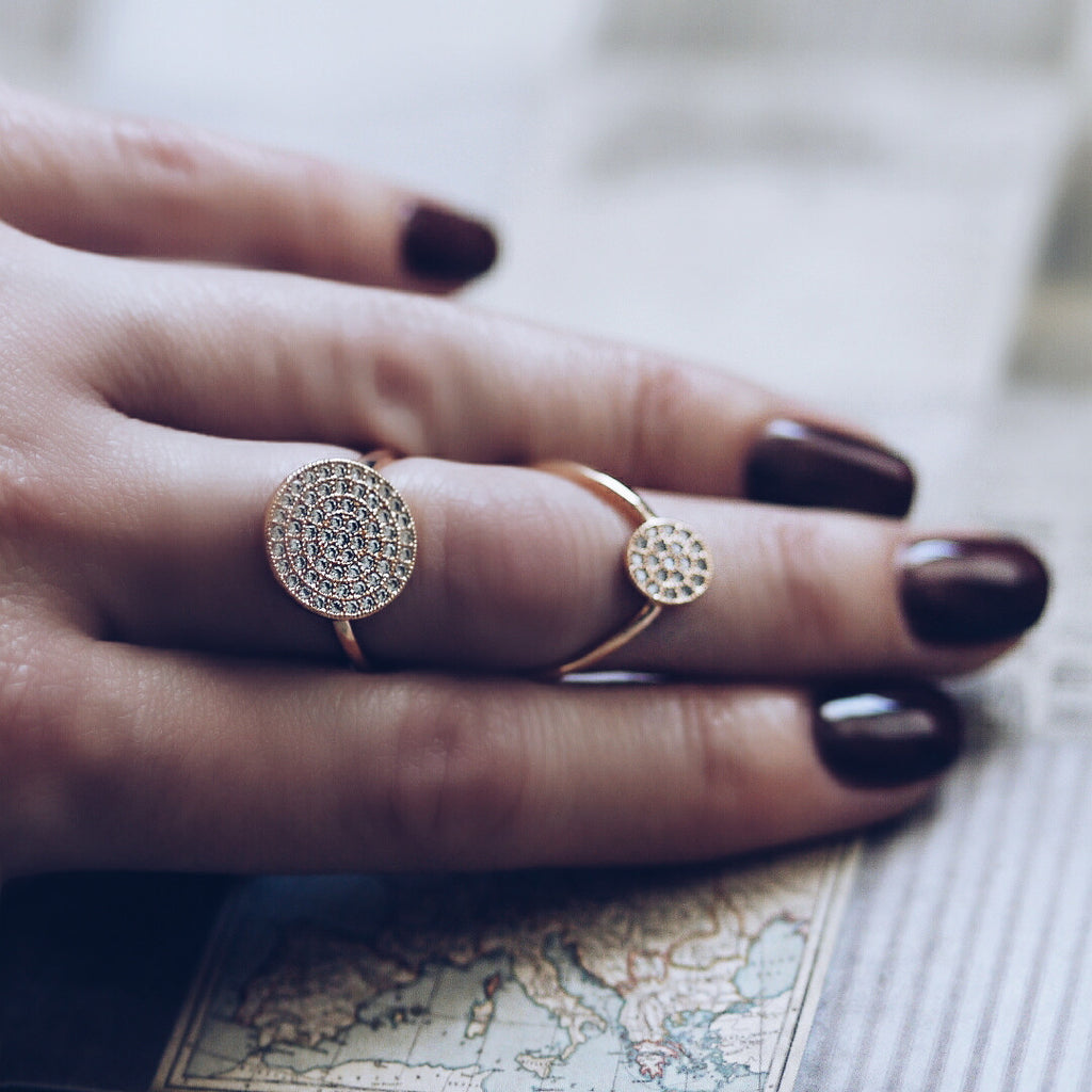 woman wearing Aurum Mod yellow gold-plated studded ring