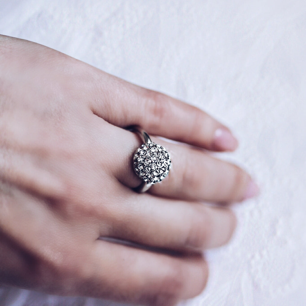 woman wearing Aurum Mod studded half sphere white gold-plated ring
