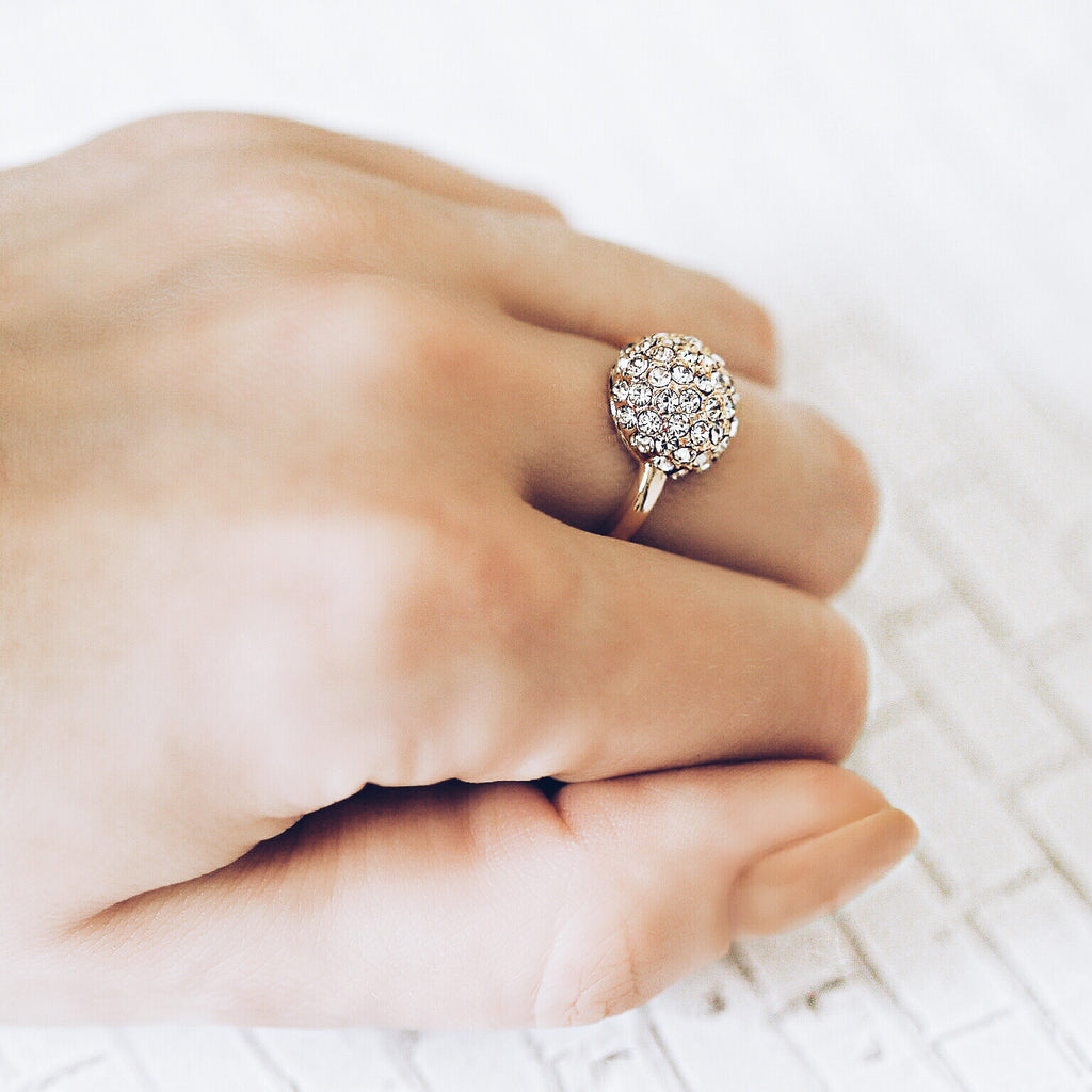 woman wearing Aurum Mod studded half sphere yellow gold-plated ring