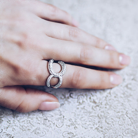 woman wearing Aurum Mod asymmetrical white gold-plated studded ring