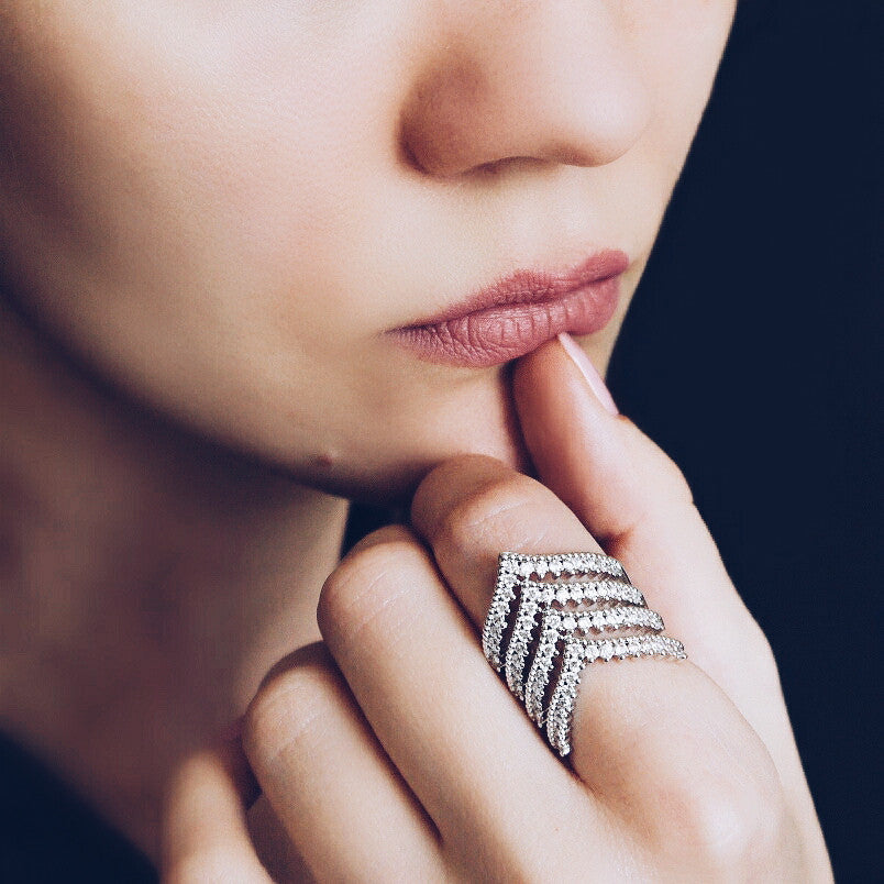woman wearing Aurum Mod chevron ring with cubic zirconia stones