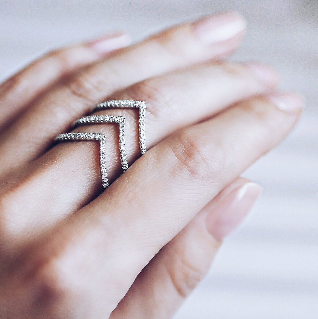 woman wearing Aurum Mod stacked chevron white gold-plated ring