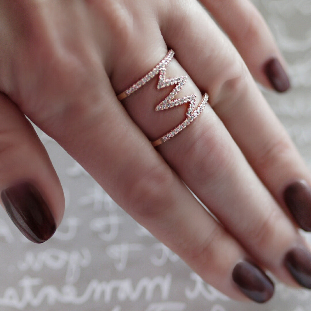 woman wearing Aurum Mod cubic zirconia rose gold-plated geometric ring