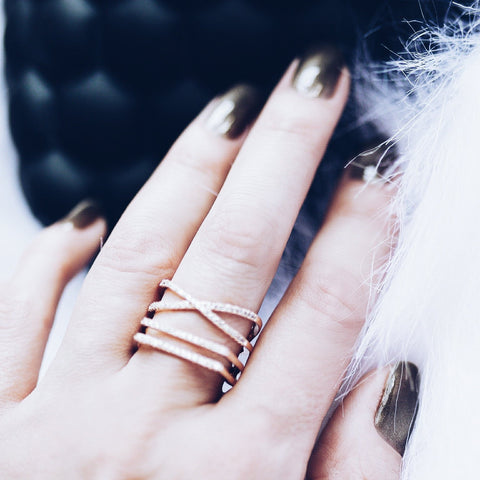 woman wearing Aurum Mod rose gold-plated stacked geometric ring