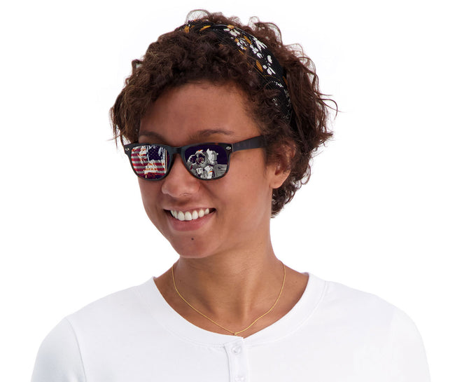Moon landing shown reflected in the lenses of Woman wearing the Cavaliers sunglasses in Tortoise