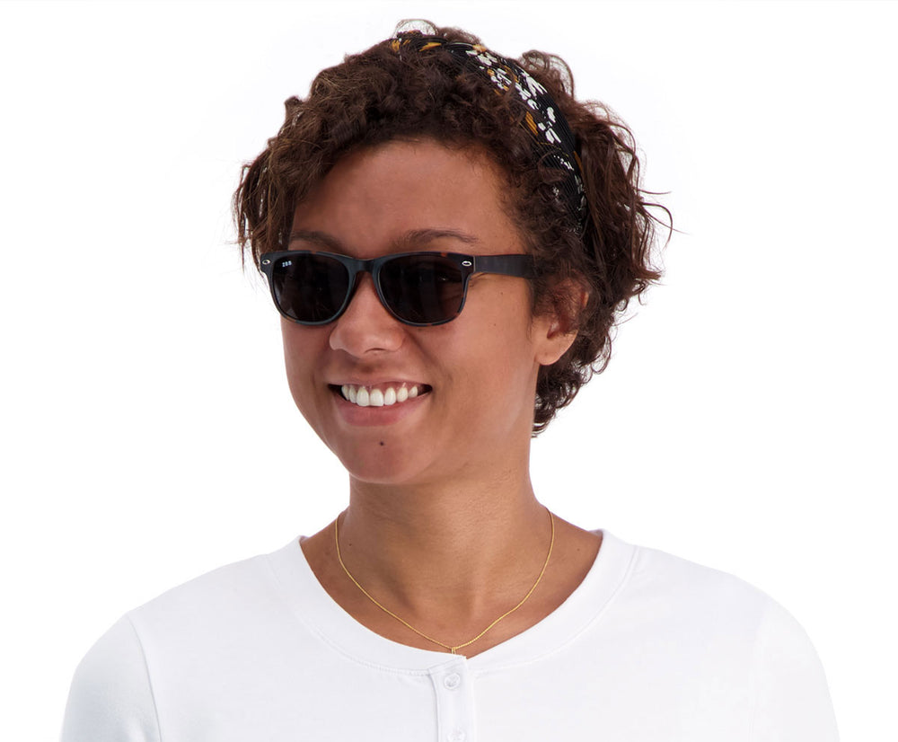 Woman wearing the Cavaliers sunglasses in Tortoise