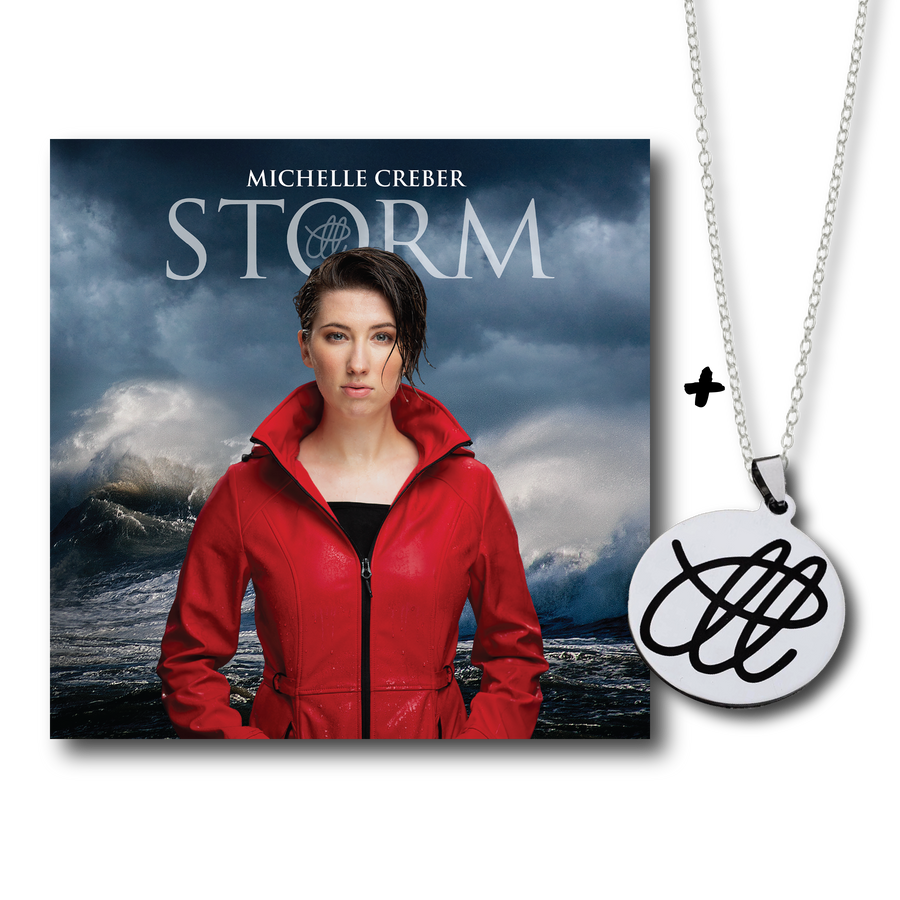 M Logo Necklace + Storm Album