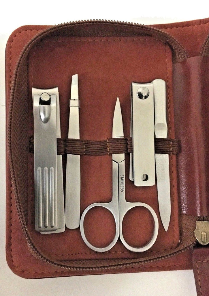 7 Piece stainless grooming set in brown PU case