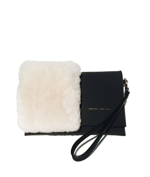 Mali leather bag with shearling details