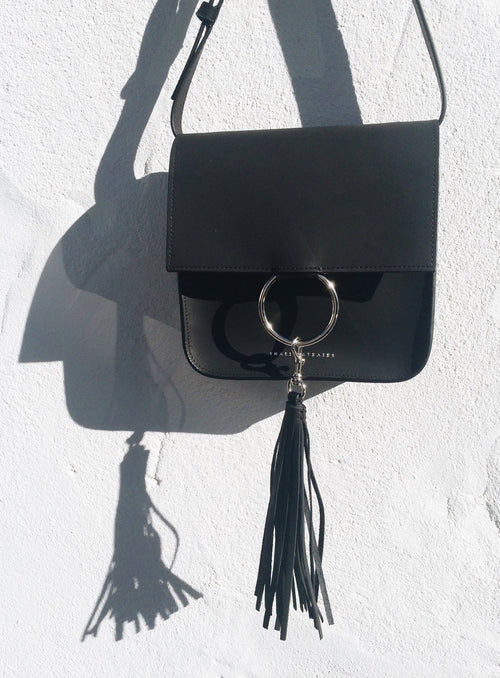 Nikki bag with extra removable tassel.