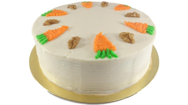 Carrot, orange and walnut cake  with  a cream cheese and whipped cream icing