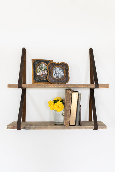 Leather strap shelves with brown reclaimed wood made from recycled Wyoming snow fences.