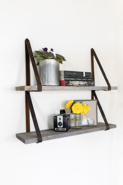 Gray leather strap shelves made with real reclaimed wood.