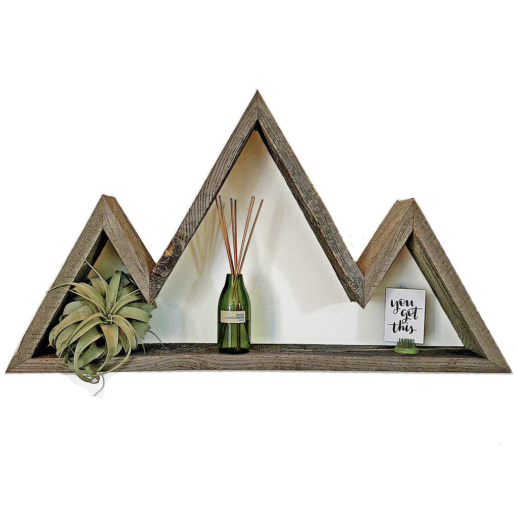 Reclaimed Wood Mountain Shelf made from recycled Wyoming snow fence boards with decor.