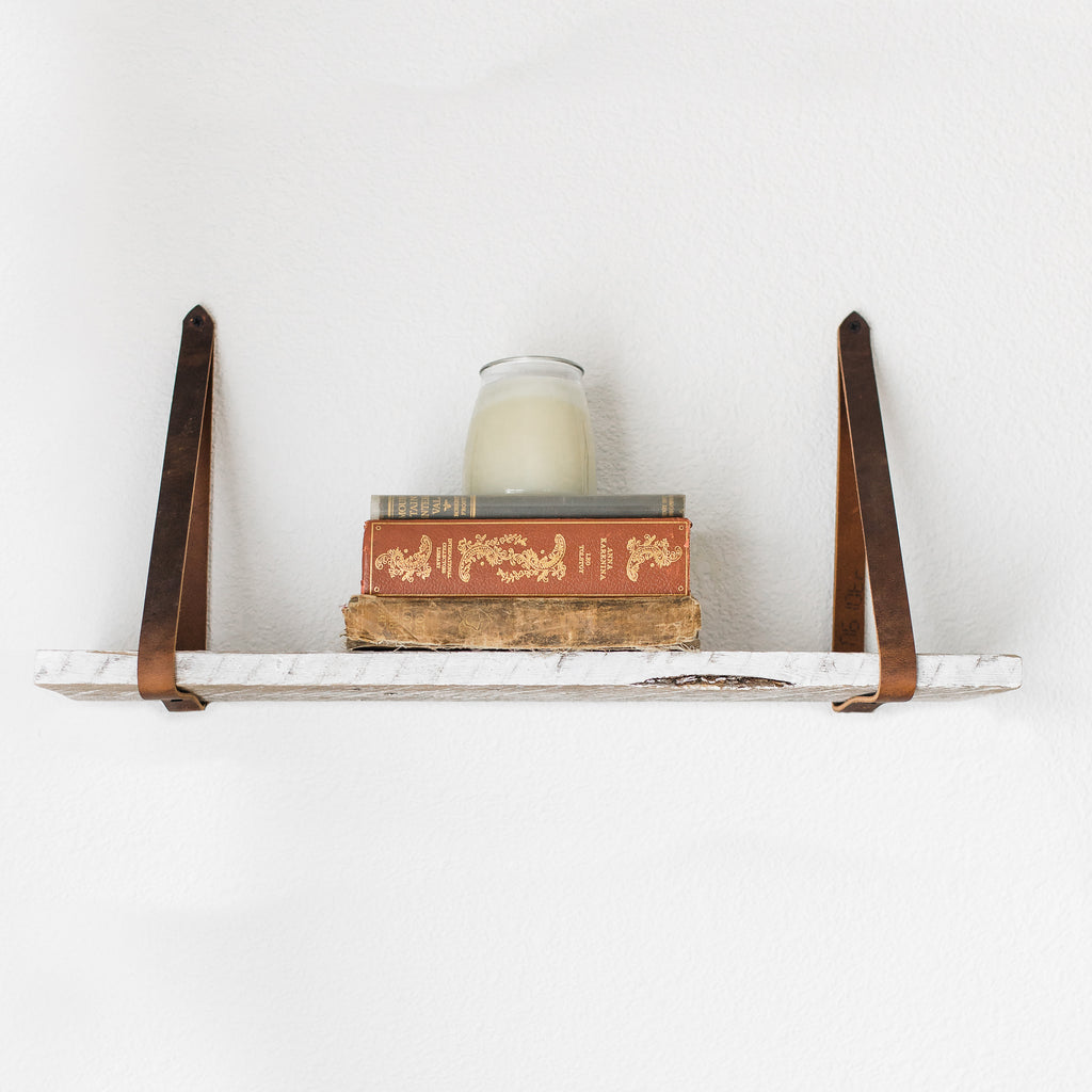 Leather strap shelf made from reclaimed wood.