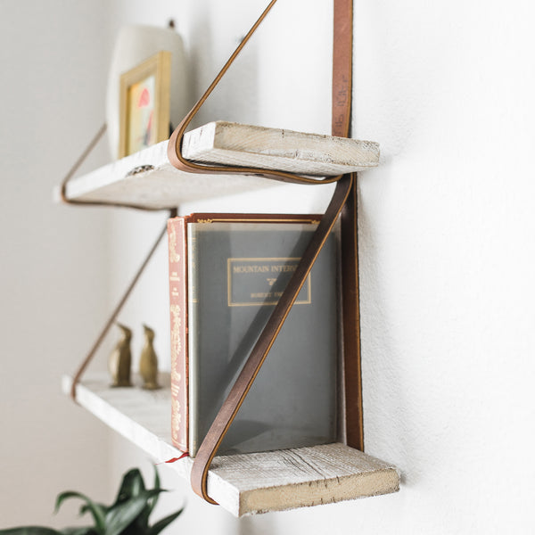 Side view of leather strap shelf with reclaimed wood boards.