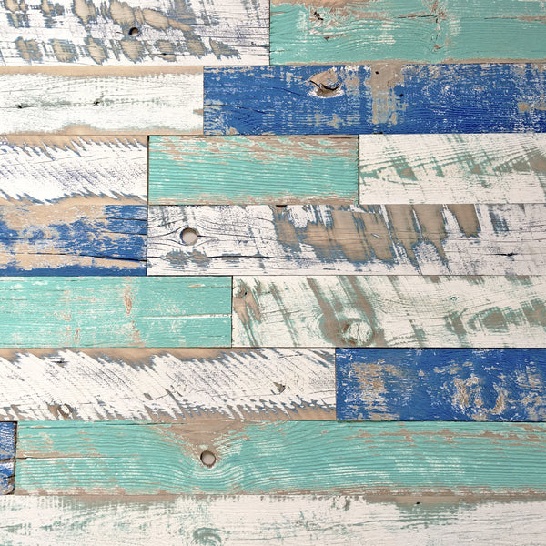 Distressed reclaimed painted boards in shades of blue in a color theme called Wind River.