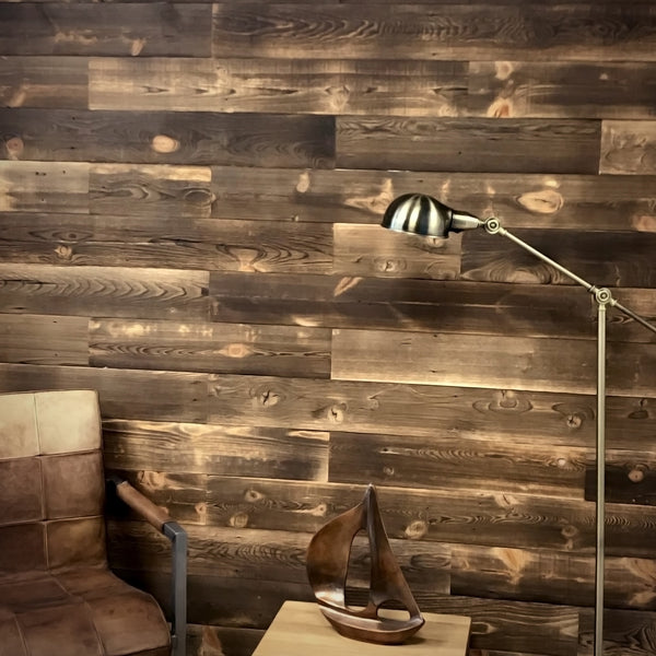 Interior accent wall using reclaimed wood planks in a shou sugi ban finish.