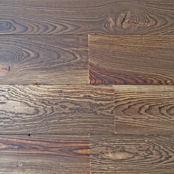 Reclaimed wood planks for interior accent walls with a shou sugi ban finish.