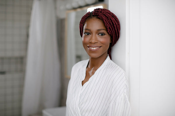 Portrait of beautiful relaxed African smiling woman looking at camera.