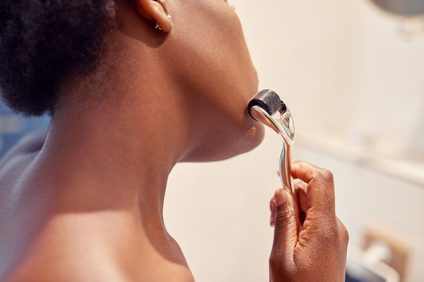 Cropped shot of a young woman using a derma roller on her skin