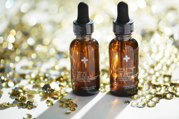 Vivant's Exfol-A and Exfol-A Forté corrective serums. Gold beads spread around.